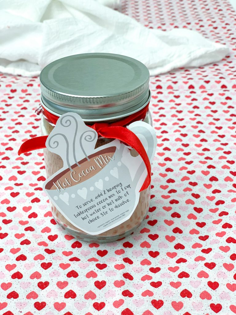 Homemade hot cocoa mix recipe with printable gift tag. Dairy Free and Vegan Hot chocolate mix recipe made with real ingredients. Hot cocoa mix in a jar.