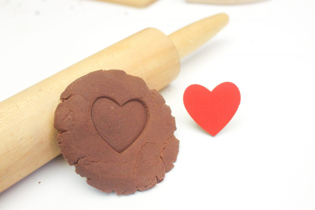 Homemade hot chocolate play dough is perfect for hands on learning and sensory play. This recipe is all natural and simple to make.