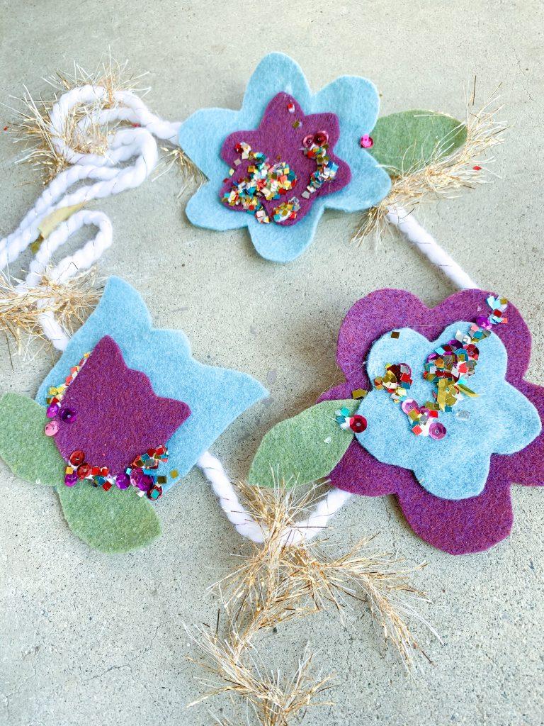 easy spring crafts for preschoolers. Felt flower garland. Spring activities for preschoolers! Find simple, easy spring activities to do with preschoolers and spring activities for kids!