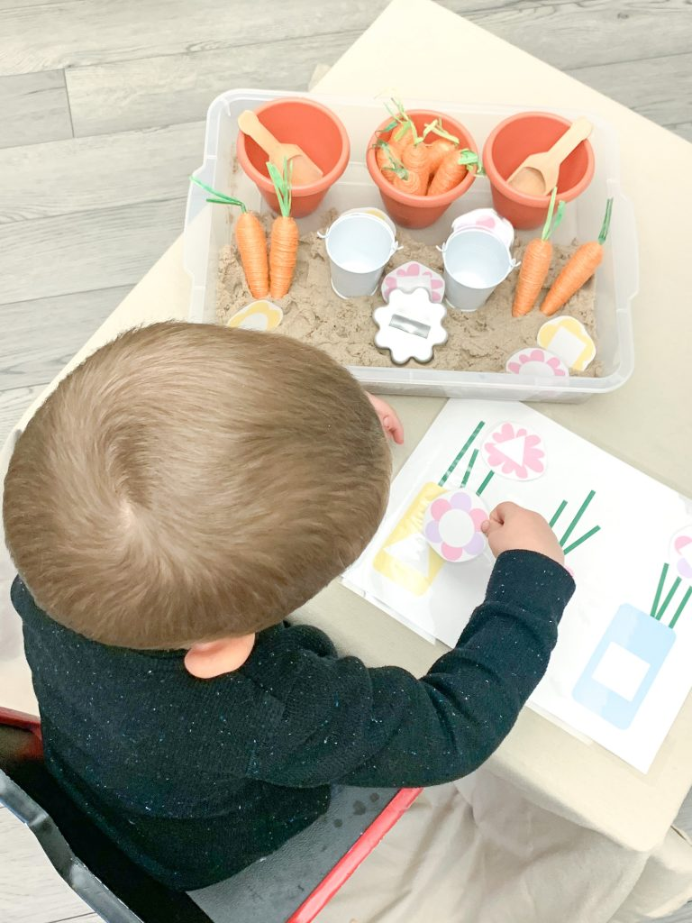 Garden Sensory Bin is a busy activity for kids. Create a sensory and learning experience using the free flower vase shape sorting download. preschool at home learning activities. spring activity ideas for preschool. Spring downloads for preschool.
